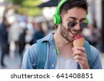 young adult man eating ice... | Shutterstock . vector #641408851