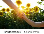 hands of mother and son holding ... | Shutterstock . vector #641414941