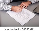 Businessman singing contract - stock photo