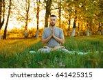 man meditating in a park at... | Shutterstock . vector #641425315