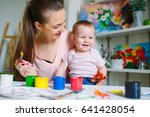 mom and daughter paint on... | Shutterstock . vector #641428054