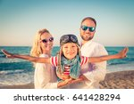 happy family on the beach.... | Shutterstock . vector #641428294