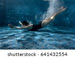 woman quickly swims under the... | Shutterstock . vector #641432554