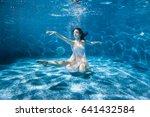 woman in a white dress is... | Shutterstock . vector #641432584