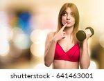 beautiful sport woman with...   Shutterstock . vector #641463001