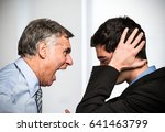 boss yelling to an employee | Shutterstock . vector #641463799