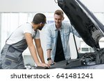 cheerful young man car owner... | Shutterstock . vector #641481241