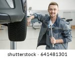 cheerful handsome auto mechanic ... | Shutterstock . vector #641481301