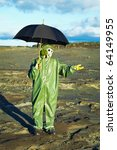 Small photo of Acid rain and men with umbrella. Chemical environment pollution concept.