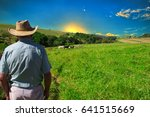 farmer looking to sunrise into...