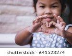 Asian Little Girl Making Heart...