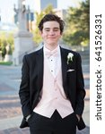Small photo of Teenager dressed in tuxedo for his first prom.