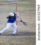 Small photo of Lacrosse Goalie with ball in the air