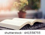 open book closeup on wooden... | Shutterstock . vector #641558755
