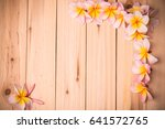 pink frangipani on wooden... | Shutterstock . vector #641572765