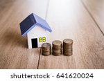 house model and coin money on... | Shutterstock . vector #641620024
