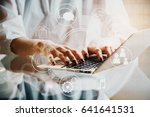woman using laptop with... | Shutterstock . vector #641641531