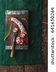 dried sausage on a rustic board ... | Shutterstock . vector #641650264