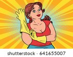 Woman In Rubber Gloves Cleaning