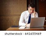 stressed businessman working on ... | Shutterstock . vector #641655469