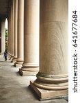 Lonely Woman besides pillars at the Harvard University in Massachusetts