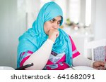 muslim woman enjoying food in... | Shutterstock . vector #641682091