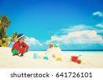 little boy play with sand on... | Shutterstock . vector #641726101