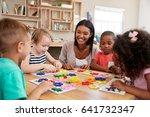 teacher and pupils using flower ... | Shutterstock . vector #641732347