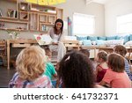 teacher at montessori school... | Shutterstock . vector #641732371