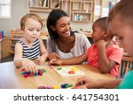teacher and pupils using wooden ... | Shutterstock . vector #641754301