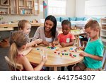 teacher and pupils using wooden ... | Shutterstock . vector #641754307