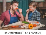 father in apron and cute little ... | Shutterstock . vector #641764507