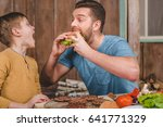 side view of man eating... | Shutterstock . vector #641771329