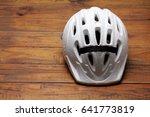 bicycle helmet on wooden... | Shutterstock . vector #641773819