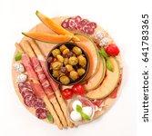 antipasti with melon  salami... | Shutterstock . vector #641783365