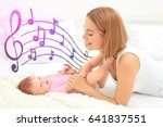 mother with baby on bed.... | Shutterstock . vector #641837551