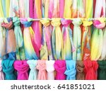 many colorful scarves hanging... | Shutterstock . vector #641851021