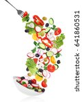 flying salad in plate with fork ...   Shutterstock . vector #641860531
