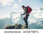 traveler man climbing with... | Shutterstock . vector #641874871