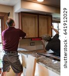 installing kitchen cabinets | Shutterstock . vector #641912029