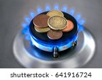 gas stove with coins in flame.... | Shutterstock . vector #641916724