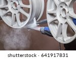 process of powder coating wheels | Shutterstock . vector #641917831