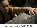 teenage girl free rock climbing