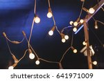 soft warm lamp lights on blue... | Shutterstock . vector #641971009