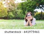 beautiful young woman outdoors. ... | Shutterstock . vector #641975461