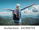 woman hiking in mountains at... | Shutterstock . vector #641985745