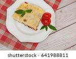 portion of tasty lasagna on... | Shutterstock . vector #641988811