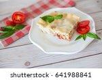 portion of tasty lasagna on... | Shutterstock . vector #641988841