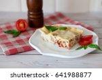 portion of tasty lasagna on... | Shutterstock . vector #641988877