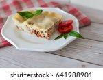 portion of tasty lasagna on... | Shutterstock . vector #641988901
